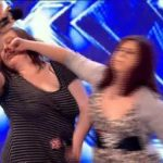 Fists fly between two contestants on the UK X-Factor