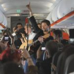 Powderfinger perform mid-flight